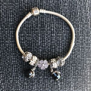 Pandora 7.5 inch silver bracelet with 7 charms